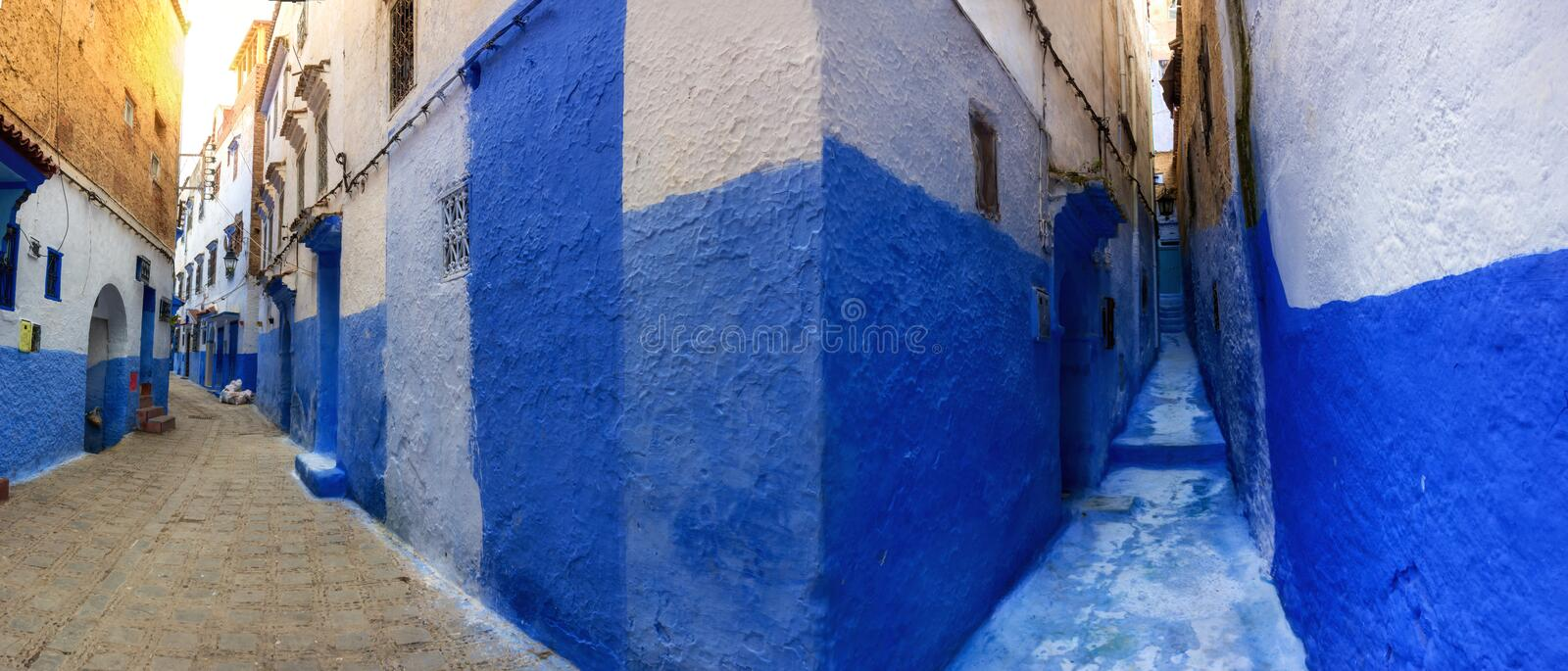 Panoramic picture of Chefchaouen`s medina, Morocco. Photomerge of a cozy street in the center of chefchaouen, Morocco stock images
