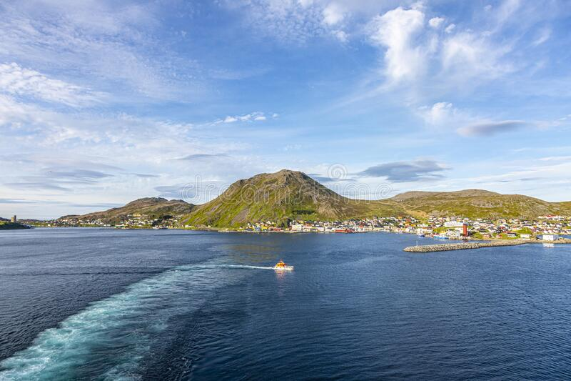 Panoramic picture of isolated Norwegian village of Honningsvag close to north cape in summer. Panoramic picture of isolated Norwegian village of Honningsvag stock photo