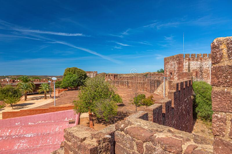Panoramic picture over courtyard of Castelo de Silves in Portugal without people in summer. Panoramic picture over courtyard of Castelo de Silves in Portugal royalty free stock image