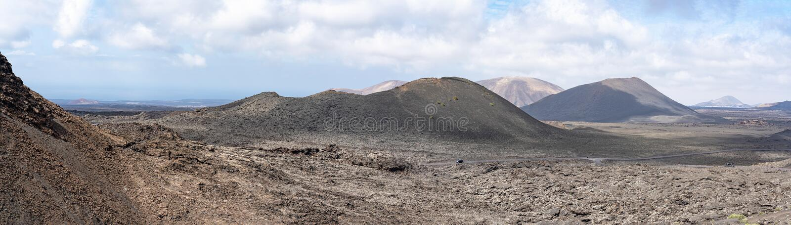 Panoramic picture of the various volcano craters in the national park Parque Nacional de Timanfaya, Lanzarote, Spain stock image