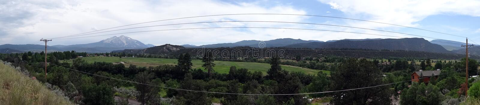 Panoramic of Powerline running through the town of Carbondale. In Colorado, USA stock photo