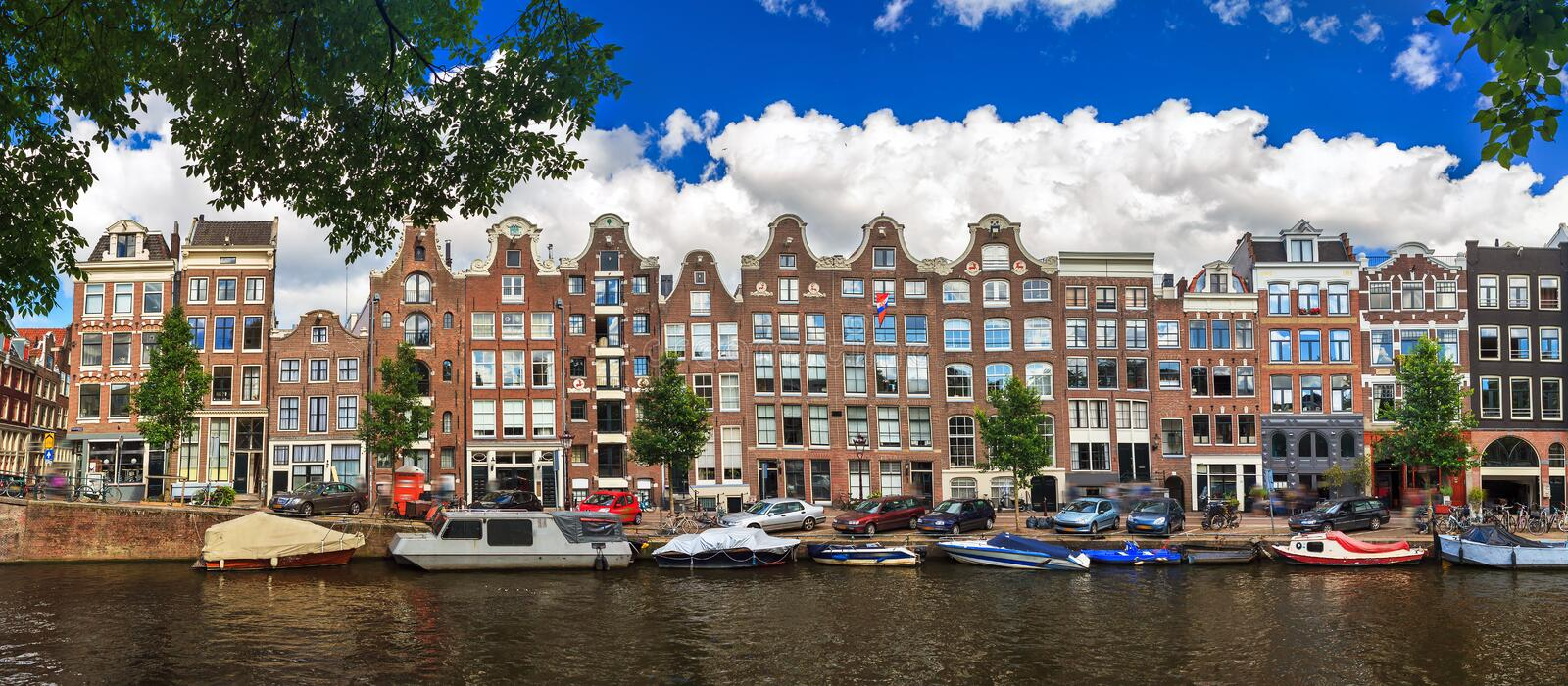Panoramic Prinsengracht. Beautiful panoramic linear panorama of the UNESCO world heritage Prinsengracht canal in Amsterdam, the Netherlands, on a sunny summer stock photo