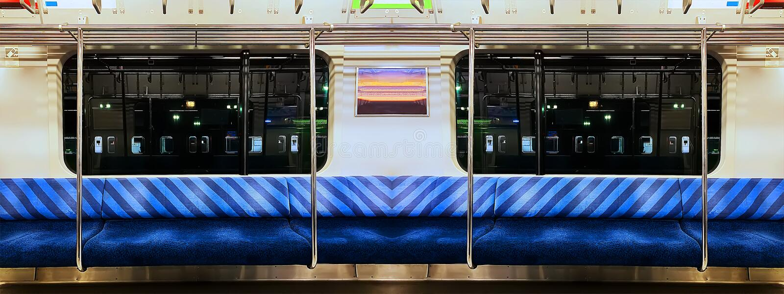 Panoramic Scene of Night Train with blue seat. Without people stock photography