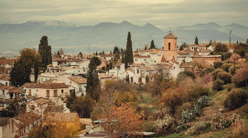 Panoramic scene with tile roofs of old houses and towers of Granada. Landscape of historical town of Andalusia, Spain. Panoramic scene with tile roofs of old royalty free stock photos