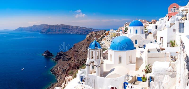 Panoramic scenic view of beautiful white houses on Santorini. Panoramic scenic view of beautiful white houses and blue domes in Oia, Santorini, Greece stock photos