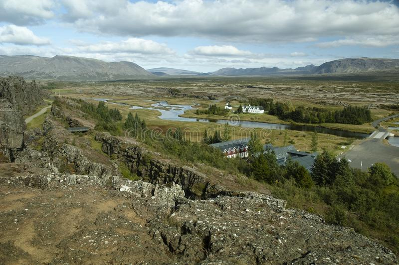 Panoramic Scenic View On A Winding River, Valley, Farmhouses And Mountains In Iceland stock images