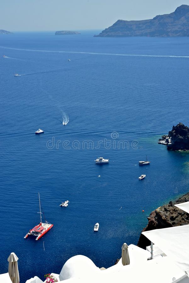 Panoramic seascape with boats of Oia stock photo
