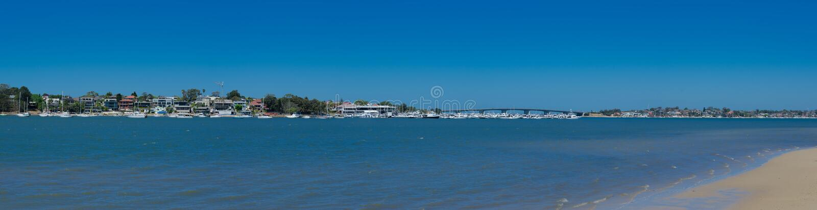 Panoramic of the seascape at Botany Bay with Captain Cook Bridge view crossing to the southern shore of Sydney, Australia. stock image