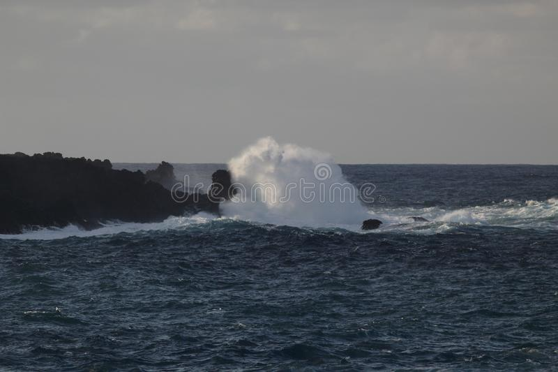 Panoramic seascape. Huge waves crashing into huge stones against the sky and horizon. West seashore of Tenerife stock photo