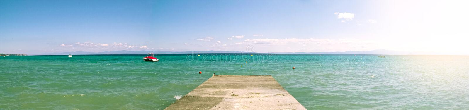 Panoramic seascape with turquoise sea and pier at sunny day. Chalkidiki also spelt Chalkidike, Chalcidice, Khalkidhiki or. Panoramic seascape with turquoise sea stock images