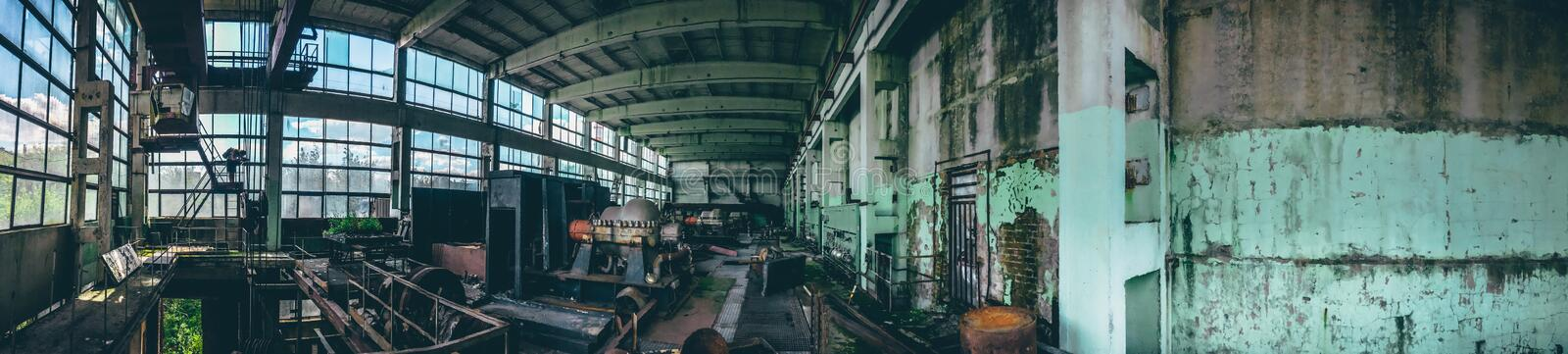 Panoramic shot of abandoned industrial factory in Efremov, Russia. Panorama of a large workshop with old and rusted equipment royalty free stock photos