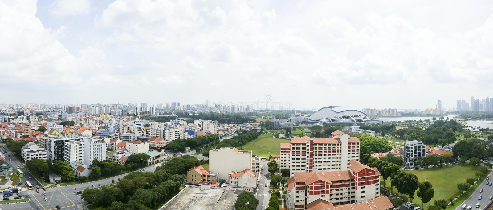 Panoramic Shot of Singapore City. A Panorama Aerial View Of Singapore City, viewed from a high rise apartment complex in Kallang. Some notable landmarks include royalty free stock photo