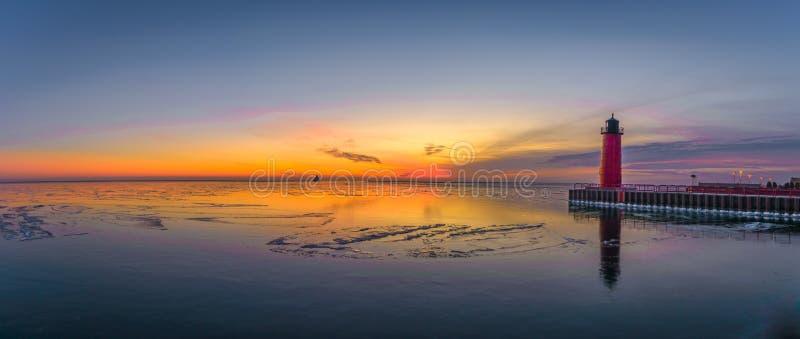 Panoramic shot of sunrise in Lake Michigan stock images