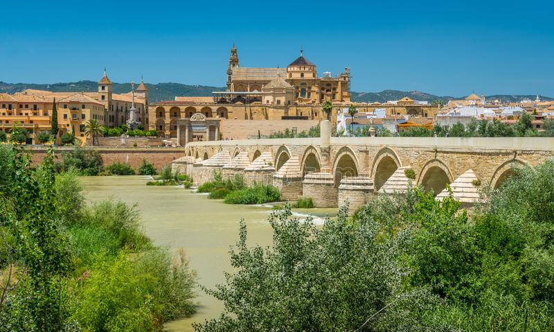 Panoramic sight in Cordoba, with the Roman Bridge and Mezquita on the Guadalquivir River. Andalusia, Spain. royalty free stock photo