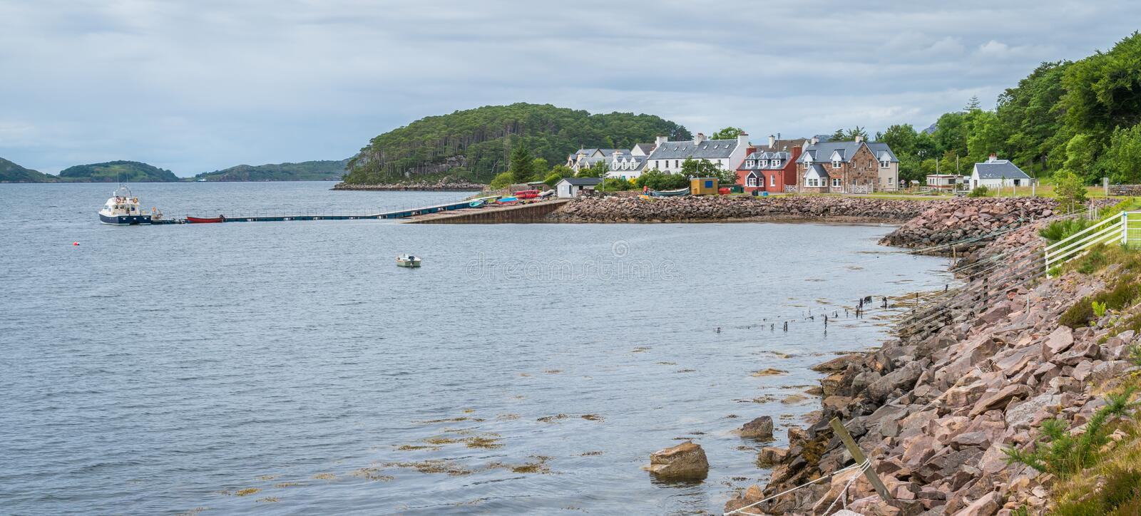 Panoramic sight of Shieldaig, village in Wester Ross in the Northwest Highlands of Scotland. Shieldaig is a village in Wester Ross in the Northwest Highlands of stock photo