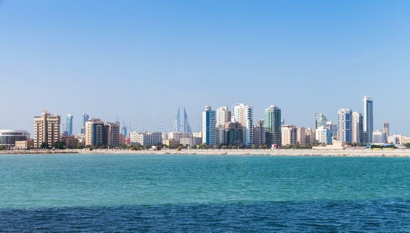 Panoramic Skyline of Manama city, Bahrain. Modern tall buildings on the horizon. Skyline of Manama city, Bahrain stock photo