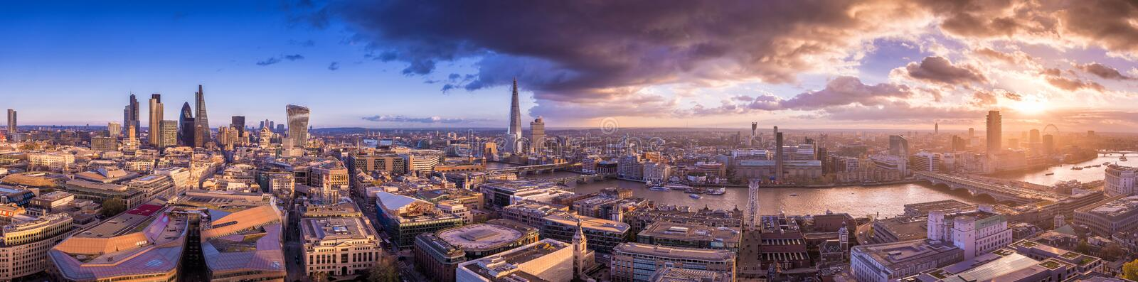 Panoramic skyline of south and east part of London with beautiful dramatic clouds and sunset - UK. Panoramic skyline of south and east part of London with stock image