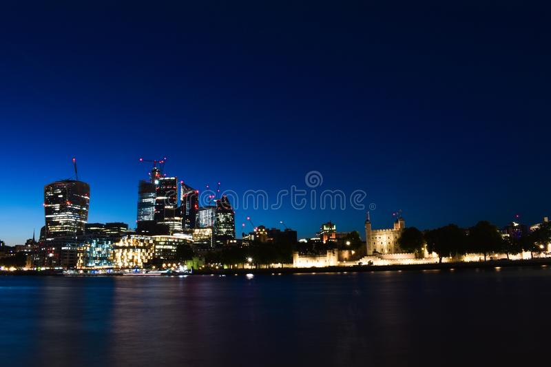 Panoramic skyline view of Bank and Canary Wharf, central London`s leading financial districts with famous skyscrapers at golden h royalty free stock photo