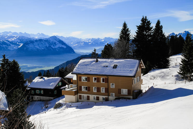 Panoramic skyline view of snow-capped chalets and. Mountains over foggy Vierwaldstattersee, snow covered Rigi, Lake Lucerne, Switzerland stock photos