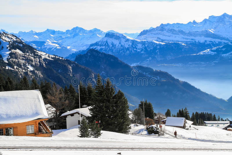 Panoramic skyline view of snow-capped chalets and. Mountains over foggy Vierwaldstattersee, snow covered Rigi, Lake Lucerne, Switzerland stock images