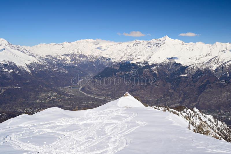 Panoramic snowy ridge. Aerial view from the top of the mountain in wonderful alpine scenery of Susa Valley (known for debated high speed train project) and Col royalty free stock image