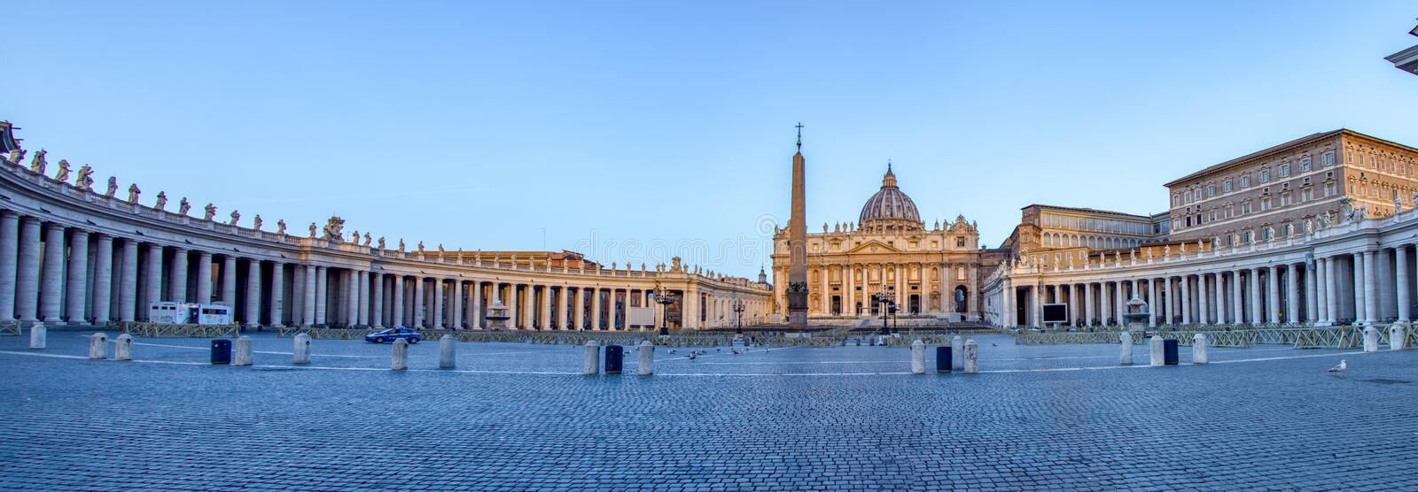St. Peter`s Square in Vatican City - Rome, Italy. Panoramic of St. Peter`s Square in Vatican City at dawn - Rome, Italy royalty free stock image