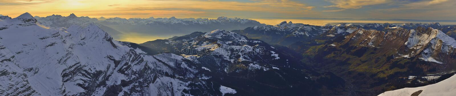 Panoramic sunset from Glacier 3000 Les Diablerets,Gstaad. Panoramic view of ski traks from Glacier 3000 Les Diablerets,Gstaad stock image