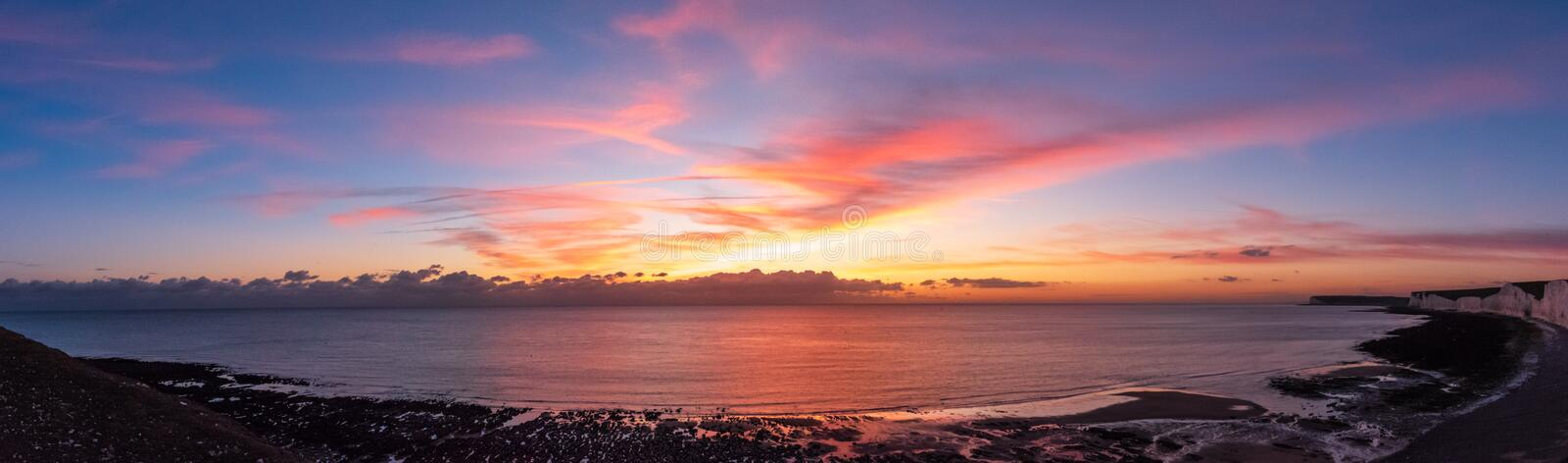 Panoramic of the sunset over the Birling Gap royalty free stock photos