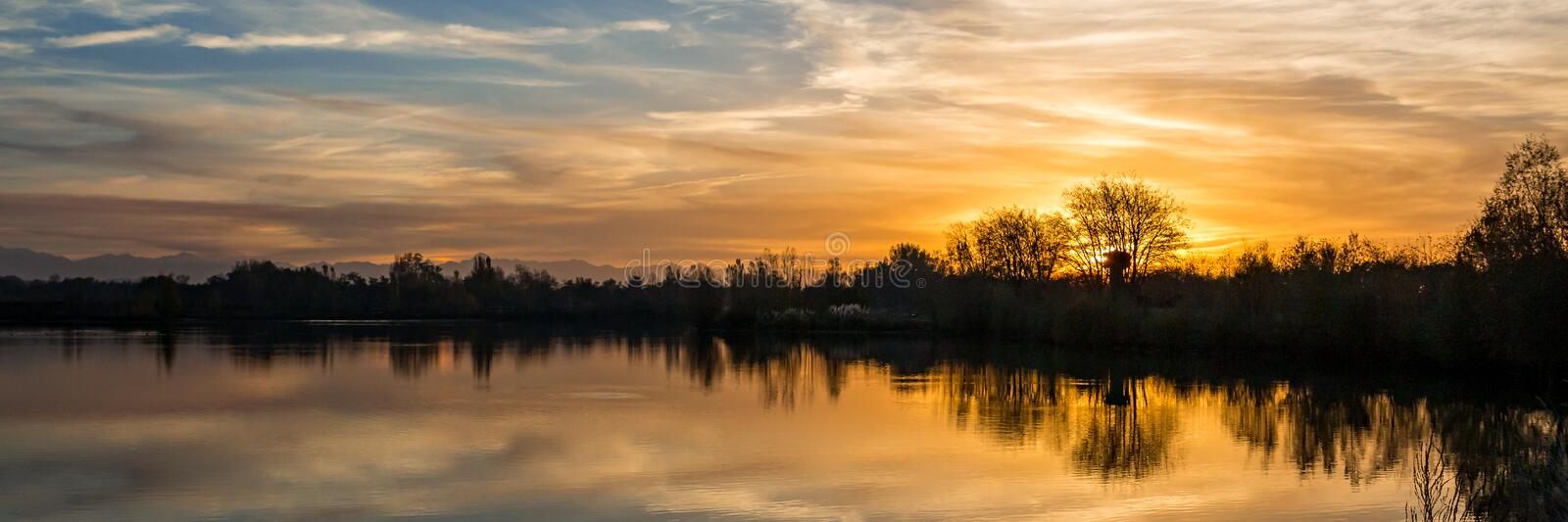 Panoramic sunset over a lake in south of Toulouse, France. Panoramic sunset over a lake in `Occitanie`, south of Toulouse, France stock images
