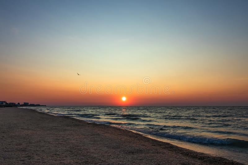 Panoramic sunset sky background. Summer beach of panoramic view. Ocean wave. Colorful seascape, beach. Sunrise by the sea. Horizon stock photo