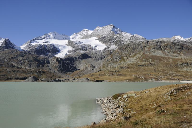 Panoramic swiss mountain landscape with Lago Bianco at Bernina Hospitz  in the Engadina stock images