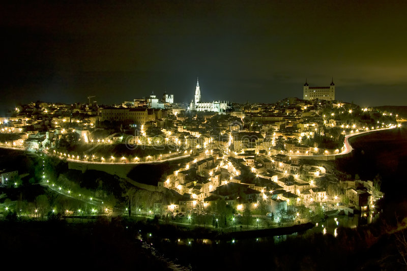Panoramic of Toledo by night stock photography