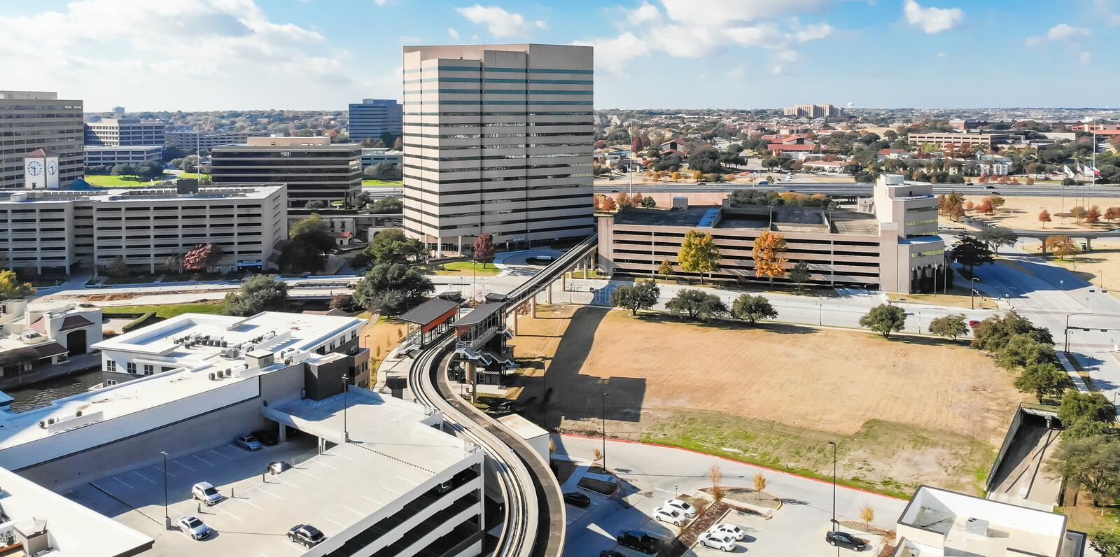 Panoramic top view light rail system and skylines in downtown La stock images