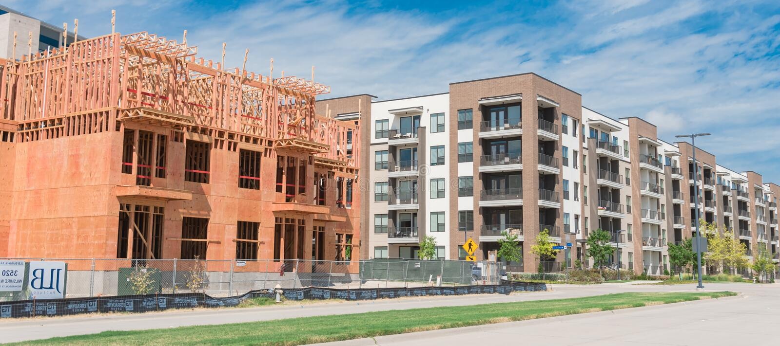 Panoramic urban upscale neighborhood with completed and under construction condos near Dallas royalty free stock photography