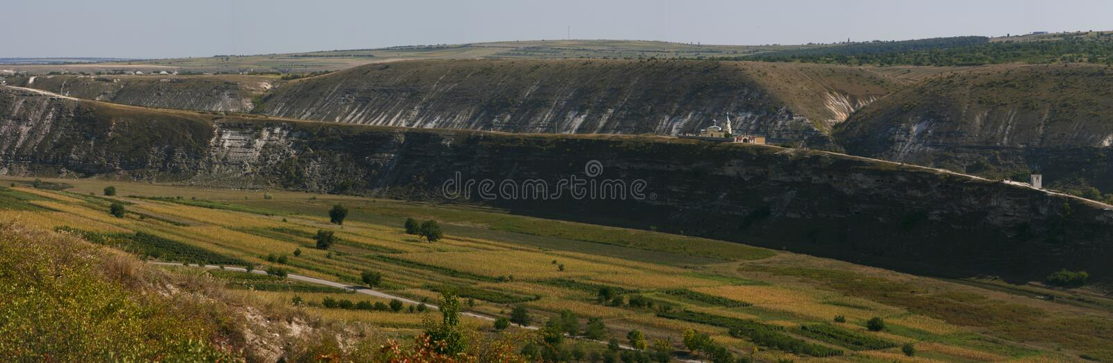 Panoramic valley with monastery royalty free stock photo