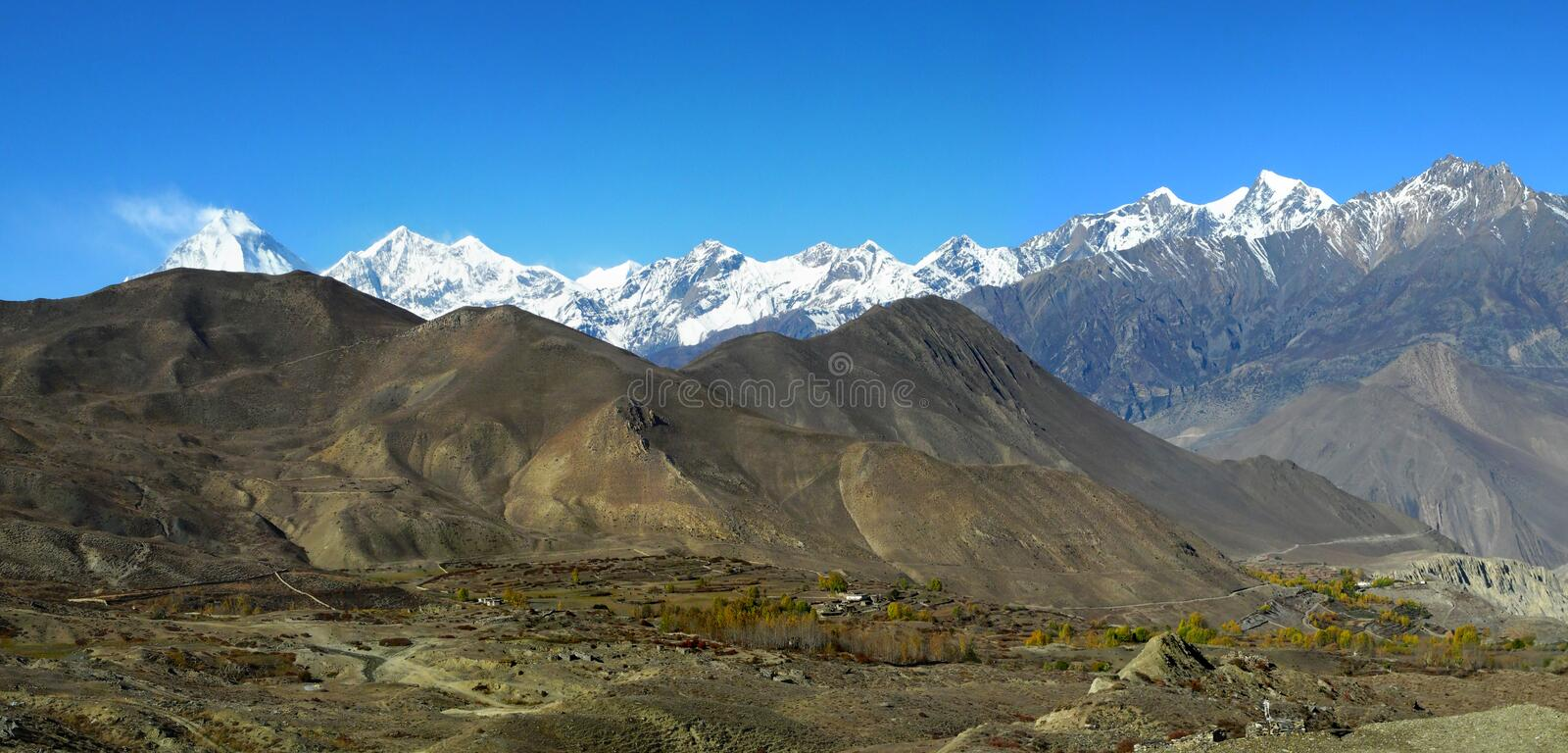 Panoramic veiw of the Himalayan Mountains and Dhaulagiri mount a royalty free stock photo