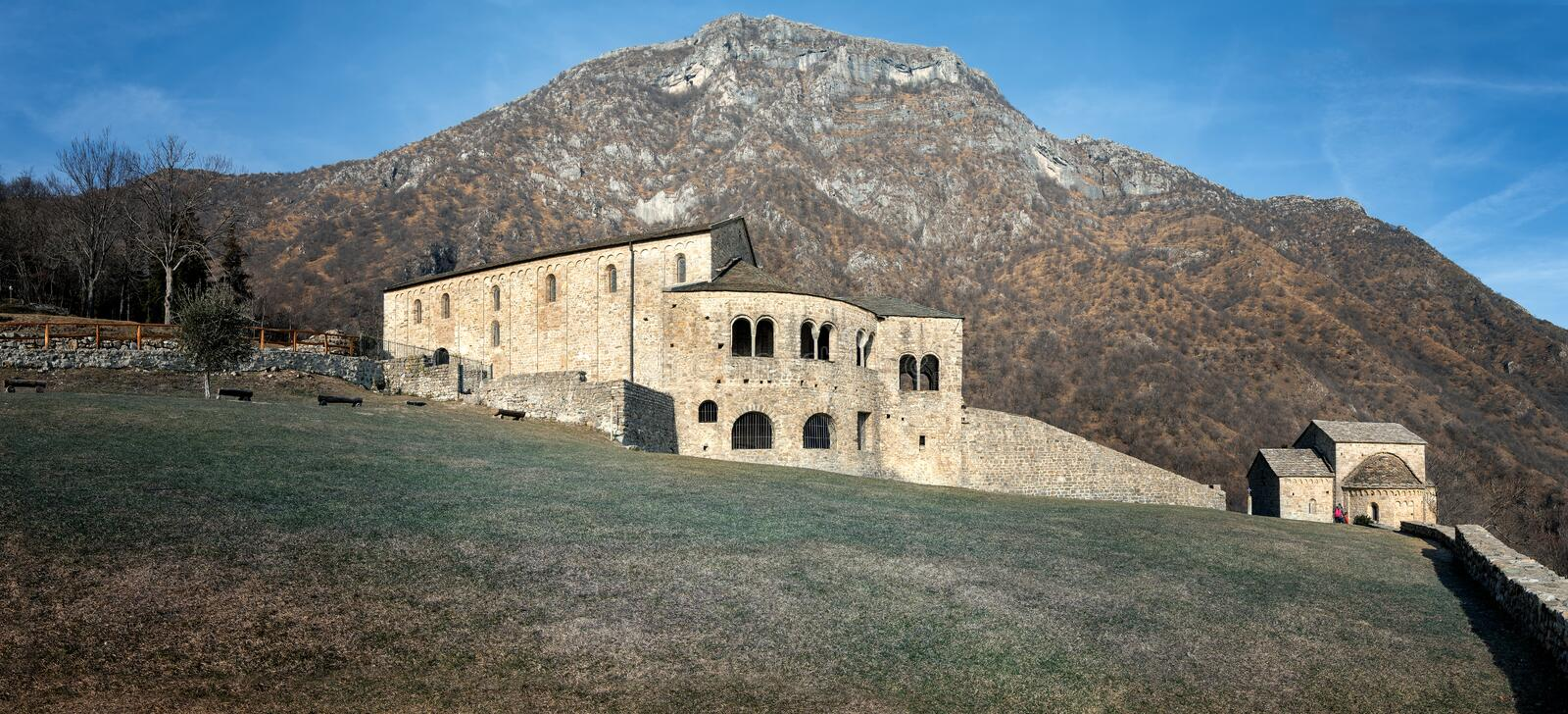 Panoramic view of the Abbey of Saint Peter in Civate. Beautiful panoramic view of the Abbey of Saint Peter between the mountains in Civate, Lombardy, Italy royalty free stock photography