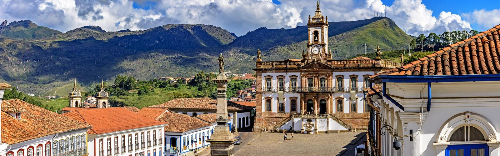 Panoramic view from above the central square of the historic city of Ouro Preto. With the museum of the inconfidence and the hills in the background stock photography