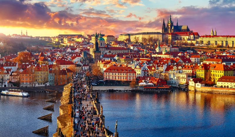Panoramic view above at Charles Bridge Prague. Castle and river Vltava Prague Czech Republic. Picturesque landscape with sunset old town houses with red tegular royalty free stock photo