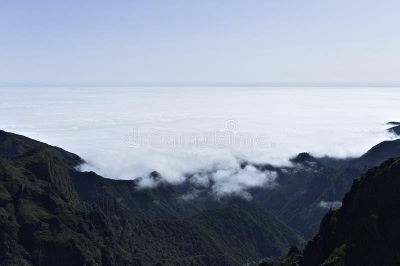 Panoramic view above clouds on `Pico do Arieiro` Sandbox Peak and `Pico Ruivo` Redhead Peak mountains Madeira, Portugal royalty free stock photos