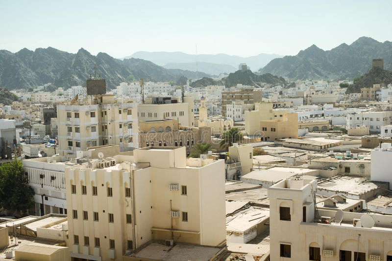Panoramic view from above of Muscat`s old town, Oman stock photography