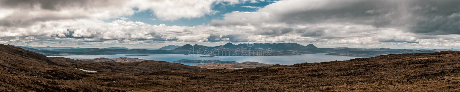 View of Isle of Skye from Bealach n Ba in Scotland. Panoramic view across Inner Sound of Raasay towards the Isle of Skye from the 626 metre high viewpoint at royalty free stock image