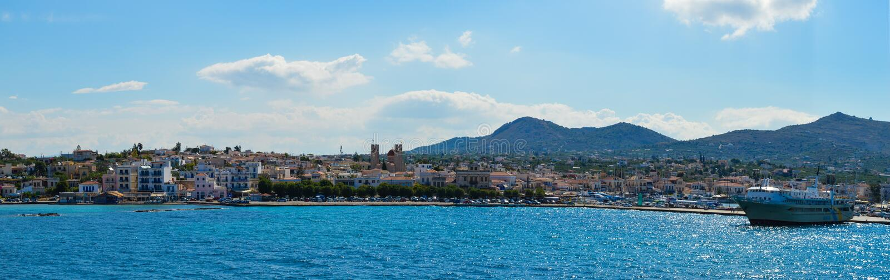 Panoramic view of Aegina port in Aegina island, Greece on June 19, 2017. AEGINA, GREECE - JUNE 19: Panoramic view of Aegina port in Aegina island, Greece on June royalty free stock photos