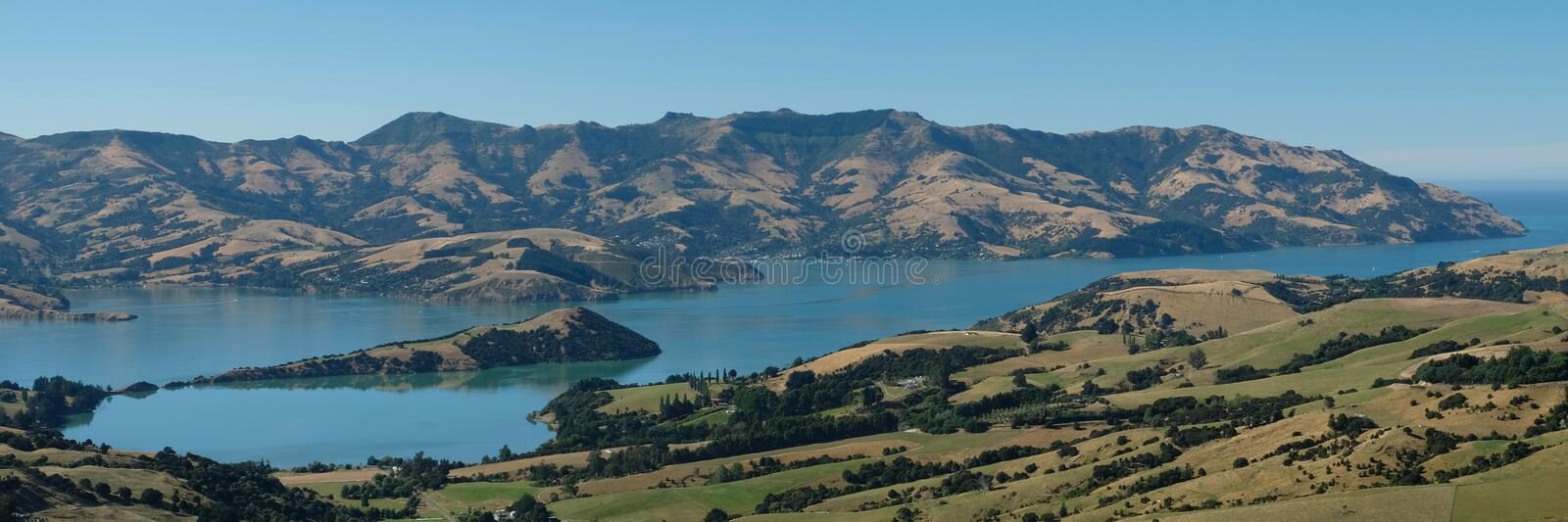 Panoramic view of Akaroa, Banks Peninsula, Christchurch New Zealand. Photo taken on a clear summer`s day. Panoramic view of Akaroa, Banks Peninsula stock photo