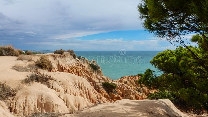 Panoramic view of the Algarve ocean cliffs, Portugal, with cloudy dramatic sky royalty free stock photo