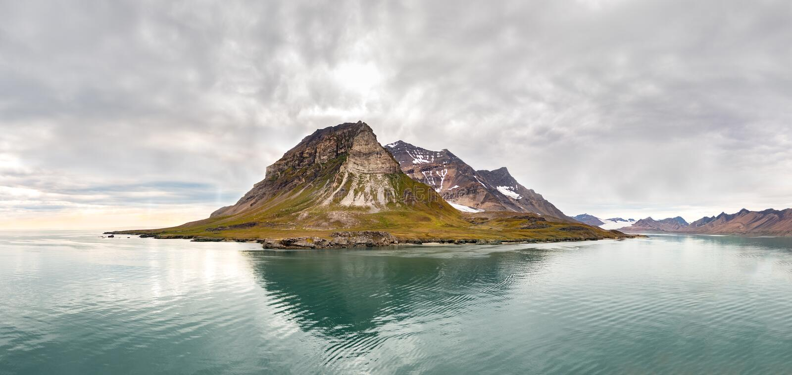 Panoramic view of the Alkhornet in Svalbard, Norway. Panoramic view of the Alkhornet, a mountain on the western coast of Spitsbergen, the largest island of royalty free stock photos