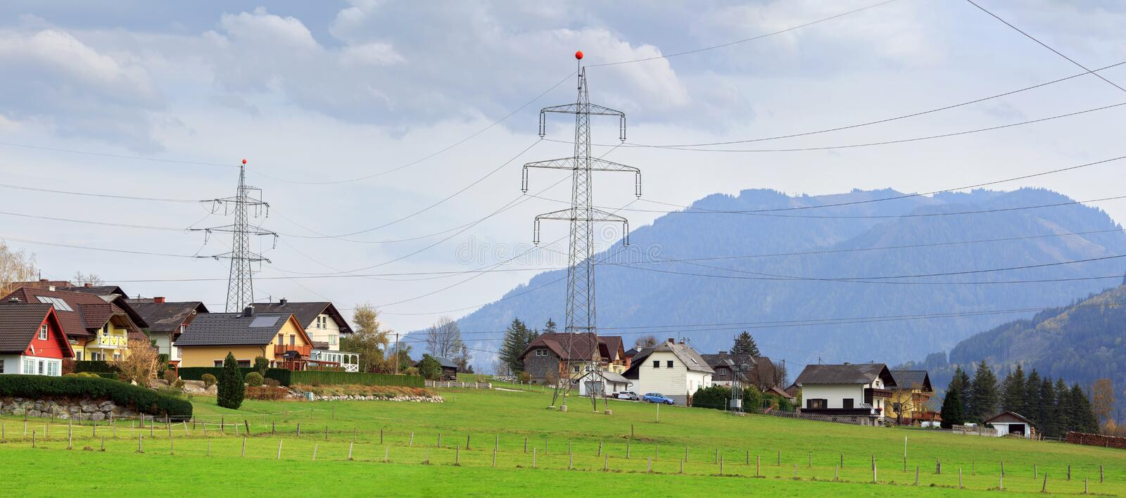 Panoramic view of the alpine village Unterburg with the power transmission line tower in the foreground. Styria, Austria, Europe. royalty free stock photography