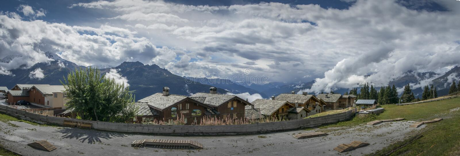 Panoramic View of the Alps. Panorama of the French Alps with Chalets in the foreground at La Rosiere, France stock photos