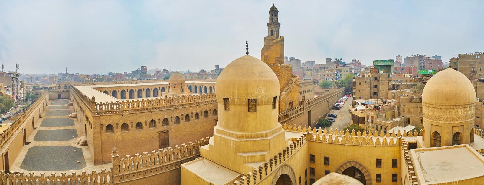 Panorama of Ibn Tulun mosque from the minaret, Cairo, Egypt. The panoramic view of Amir Sarghatmish mosque and Ibn Tulun mosque from the tall minaret royalty free stock photo