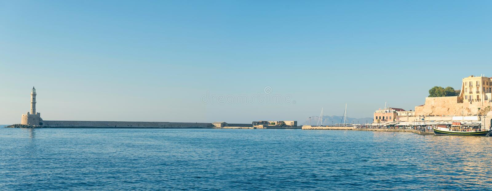Panoramic view of the antiquity lighthouse in the old Venetian harbor Of Chania. Island of Crete. Greece royalty free stock image